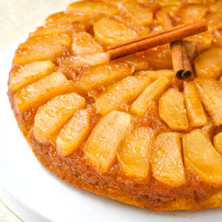 Apple Upside Down Cake close up photo of a single slice on a white plate 2