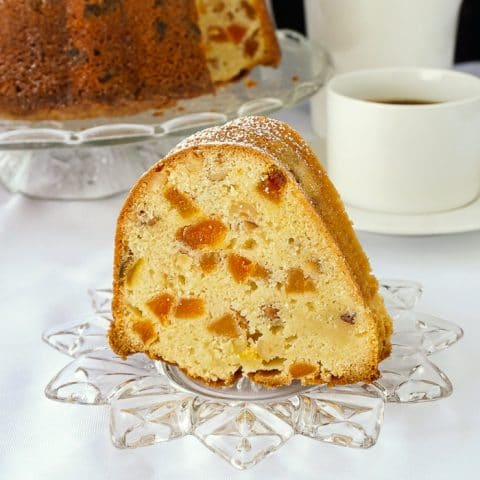 Apricot Hazelnut Pound Cake photo of a single slice on a clear glass dessert plate