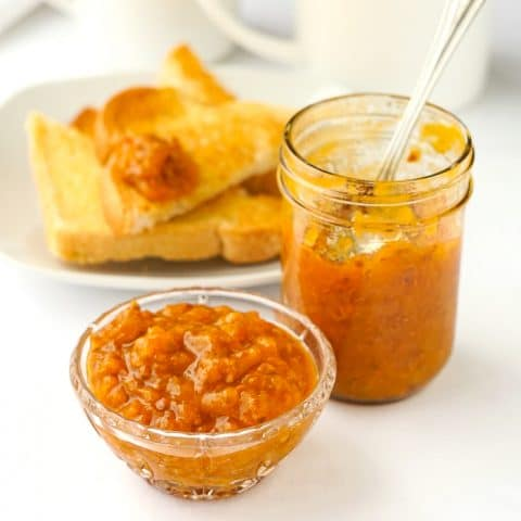Bakeapple Jam in a mason jar and spooned into a small glass dish