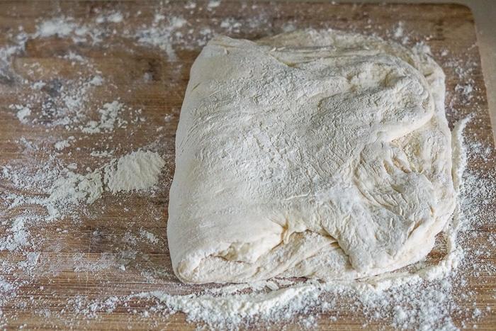 Begin folding the dough into shape