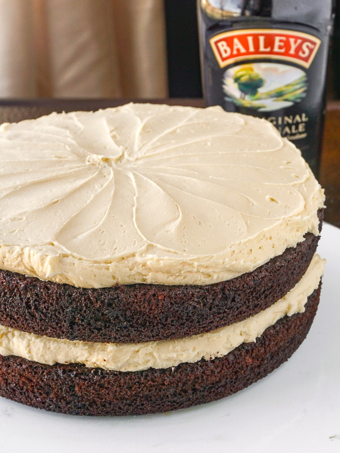Close up photo of Irish Coffee Cake with Baileys Irish Cream in the background