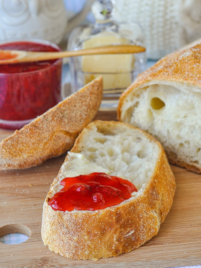 Close up photo of a slice of bread with jam.