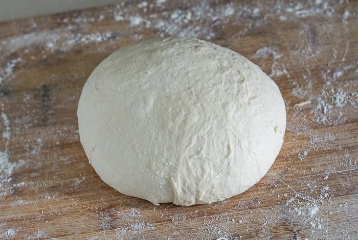 Dough formed into a well shaped ball.