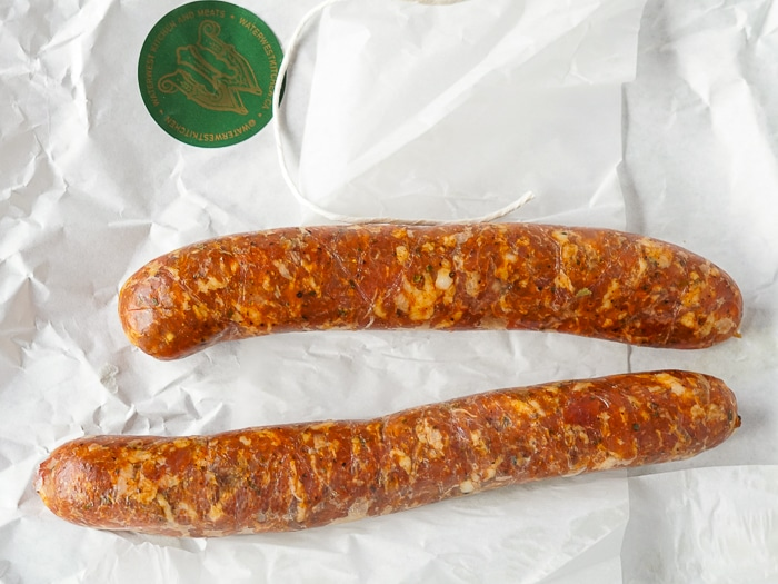 Good quality sausages on white butcher wrapping paper.