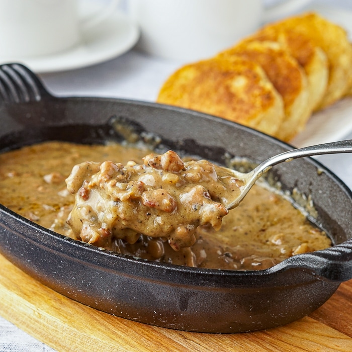 Sausage gravy served a cast iron serving dish