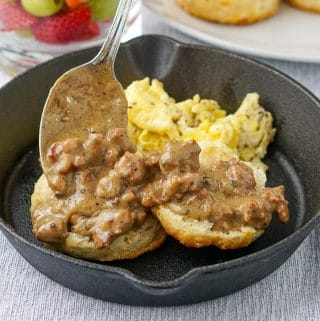 Southern Sausage Gravy biscuits and scrambled eggs in a cast iron pan