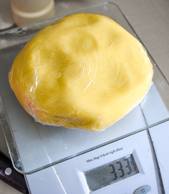 Wrap portions of dough in plastic wrap and rest in the fridge.