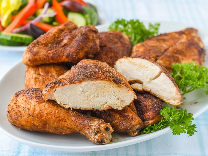 Copycat KFC Roast Chicken with one breast piece sliced in half