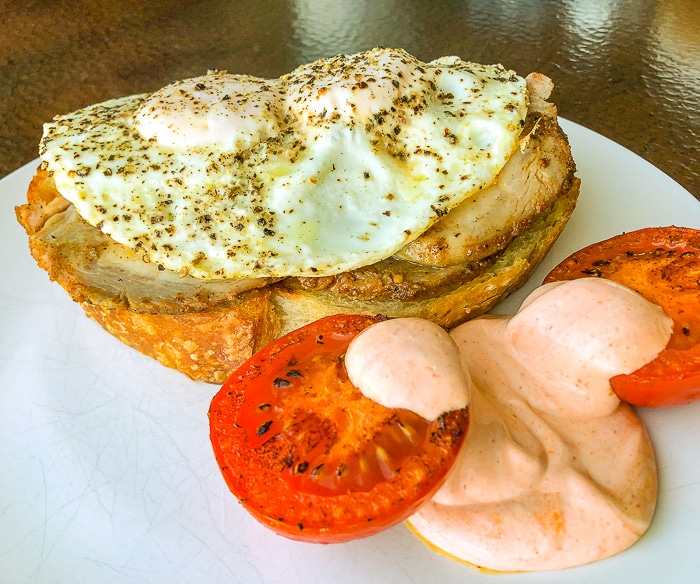 Brined Roast Pork Loin on sourdough with eggs and fried tomatoes.