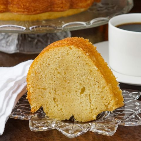Jamaican Rum Cake photo of a single slice on a clear glass plate