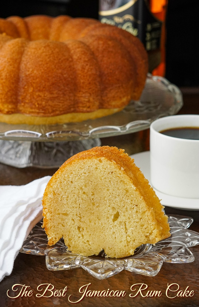 Jamaican Rum Cake photo of a single slice with title text added for Pinterest