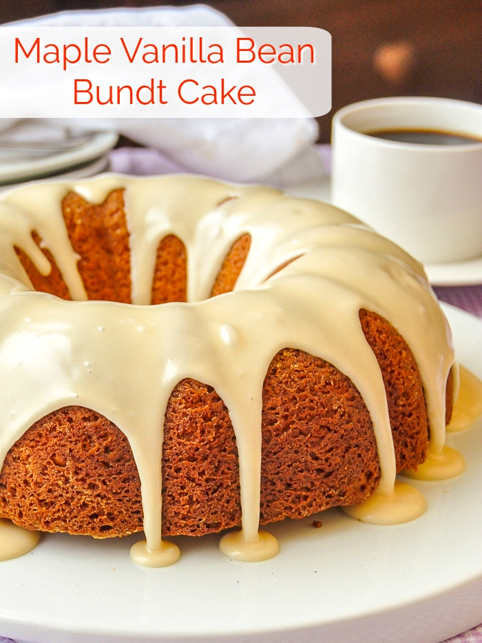 Maple Vanilla Bean Bundt Cake photo of uncut cake on a white plate with title text added for Pinterest