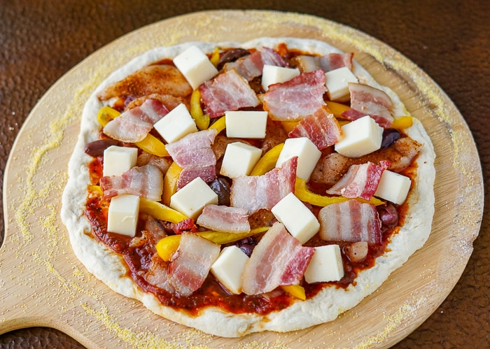 Pizza with toppings ready for the oven.