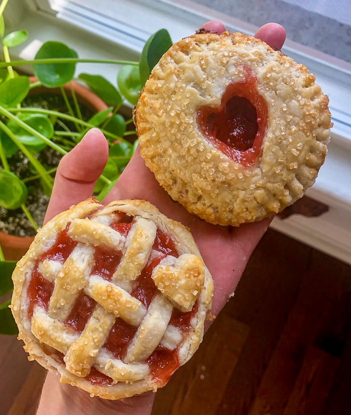 2 Oven Baked Hand Pies showing a lattice top and a heart cutout top