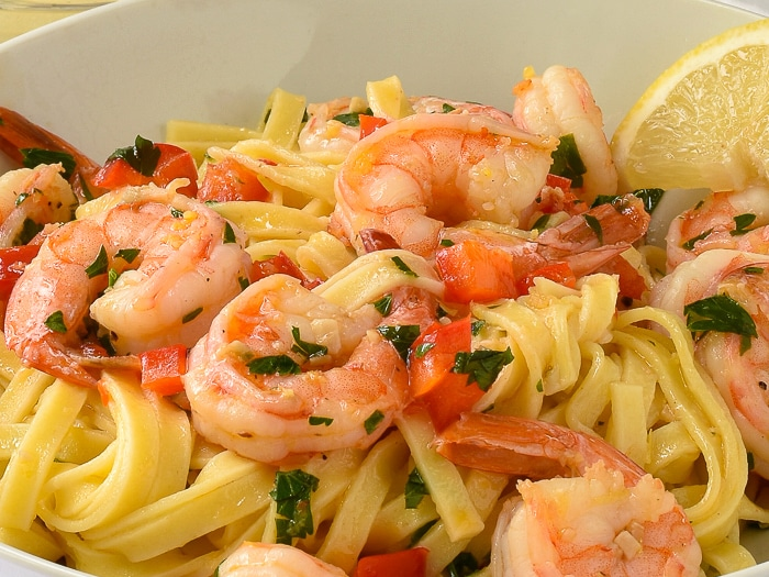Super simple shrimp scampi close up photo of single serving in a white bowl