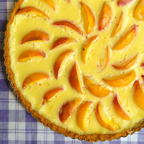 Summer Peach Custard Tart close up photo of uncut tart