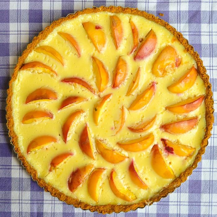 Summer Peach Custard Tart overhead overhead photo of uncut tart.