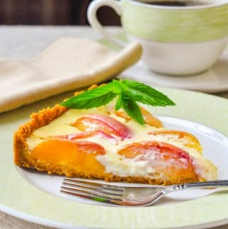 Summer Peach Custard Tart single slice on a green and white plate