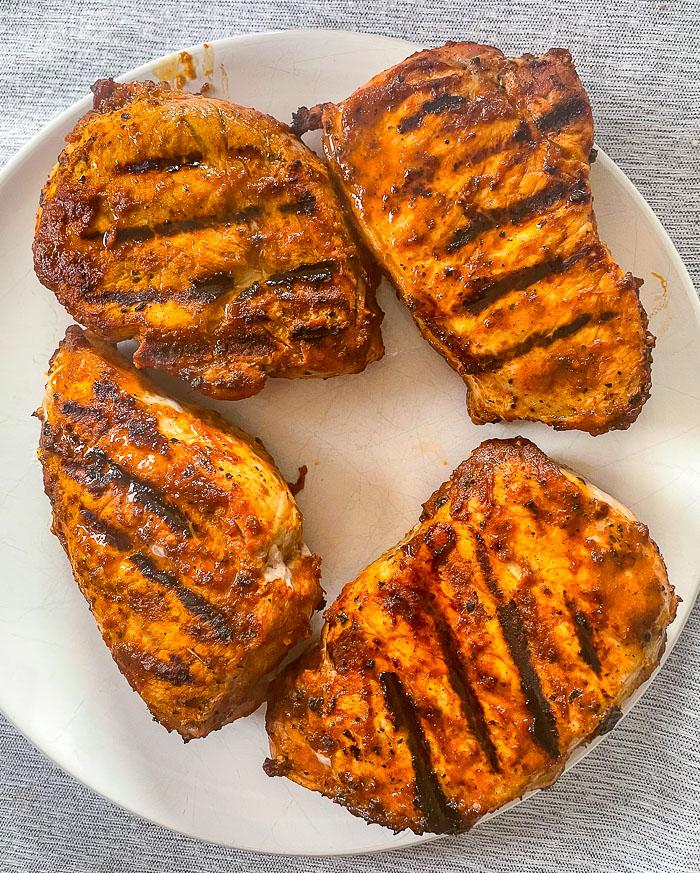 Peri peri sauce on grilled centre loin pork chops.