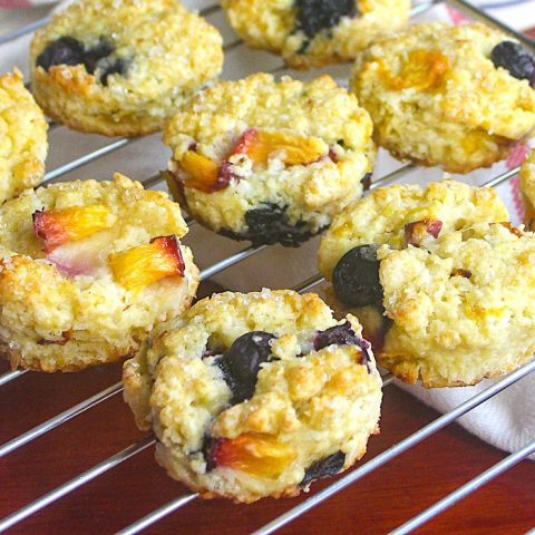 Blueberry Peach Coconut Scones close up photo of scones cooling on a wire rsack