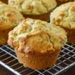 Multigrain Muffins. Close up of one muffin cooling with the others on a wire rack
