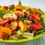 Close up featured photo of Honey Lemon Vinaigrette on Peach Bacon Salad