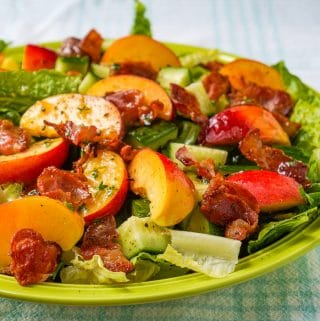 Close up featured photo of Honey Lemon Vinaigrette on Peach Bacon Salad
