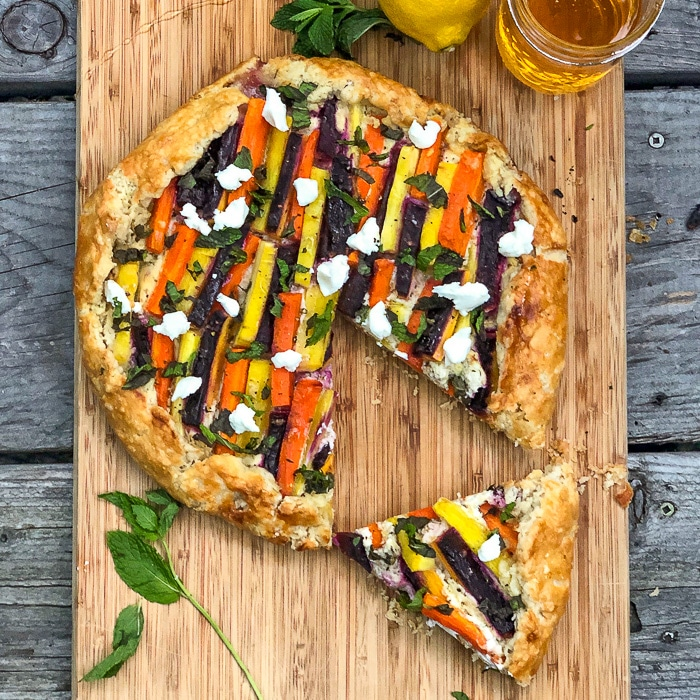 Vegetable Galette with Whipped Goat Cheese, Mint and Honey over head shot with lemon and herbs
