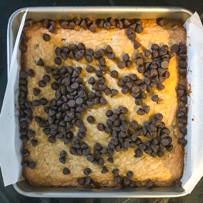 Adding the chocolate chips to the top layer
