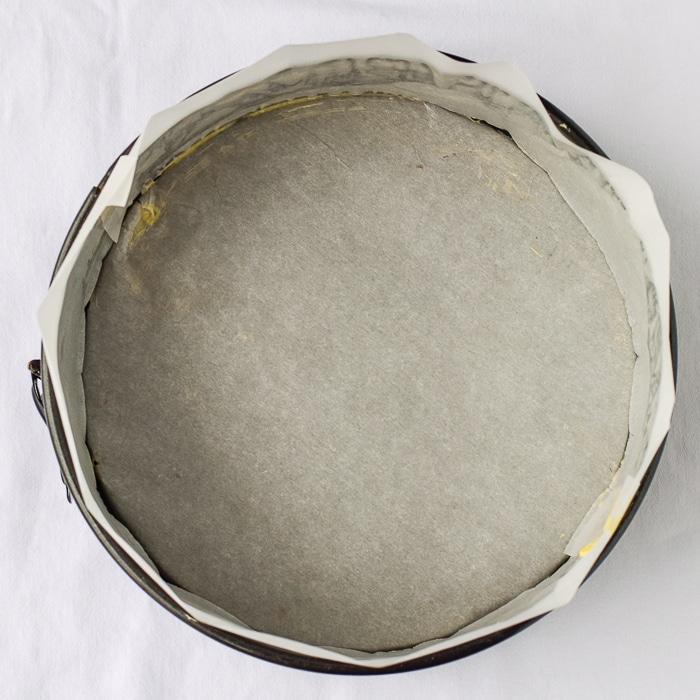 Overhead shot of parchment paper lined springform pan