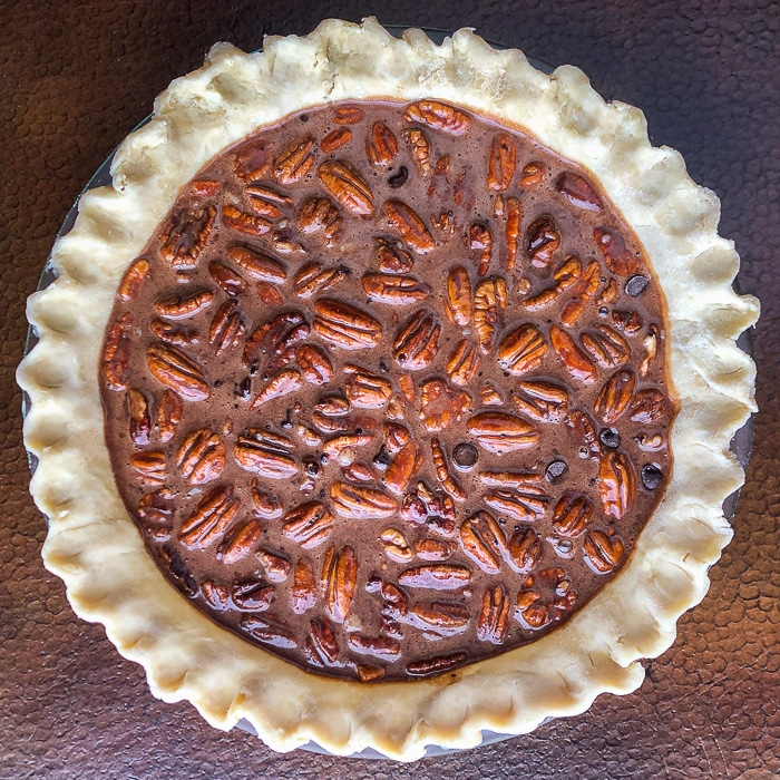 Chocolate Bourbon Pecan Pie ready for the oven