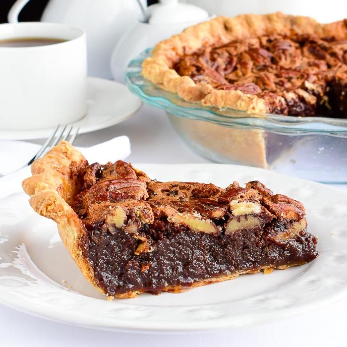 Close up photo of a single slice of Chocolat Bourbon Pecan Pie