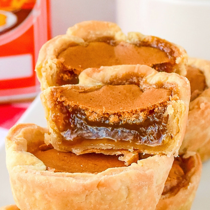 Close up photo showing the filling of one butter tart