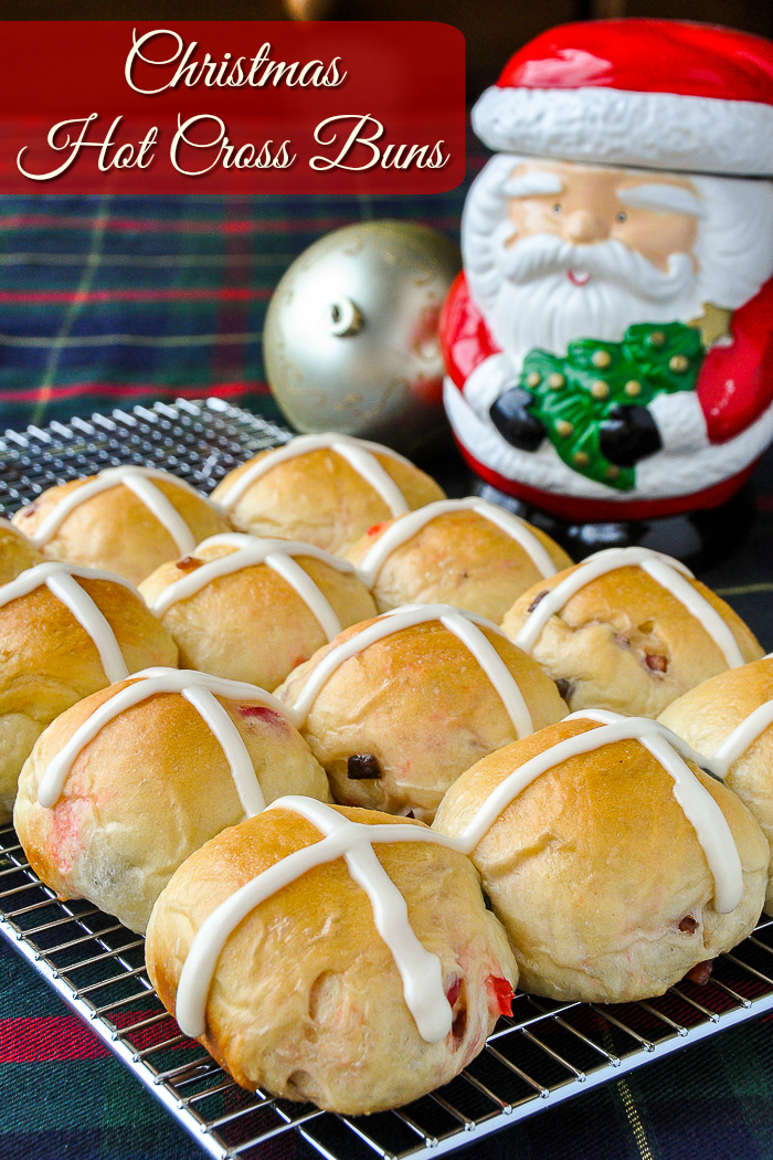 Christmas Hot Cross Buns cooling on a wire rack with title text added for Pinterest