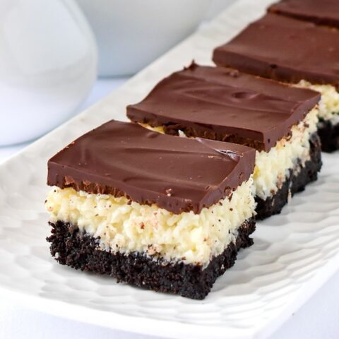 Close up photo of Coconut Bounty Cookie Bars on a white platter