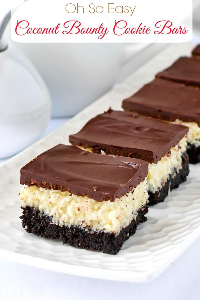Coconut Bounty Cookie Bars on a white platter with title text added for Pinterest