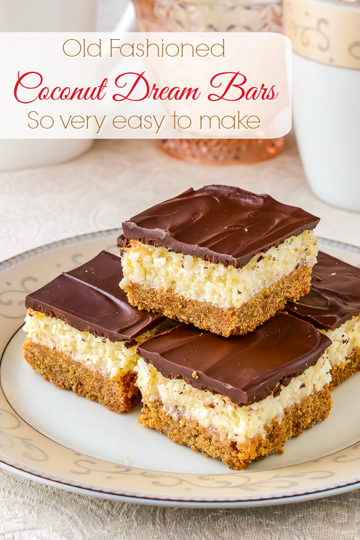 Coconut Dream Bars pictured stacked on a pink and white plate with title text added for Pinterest 2