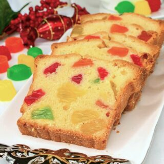 Gumdrop Cake photo of several cake slices on a white and silver platter