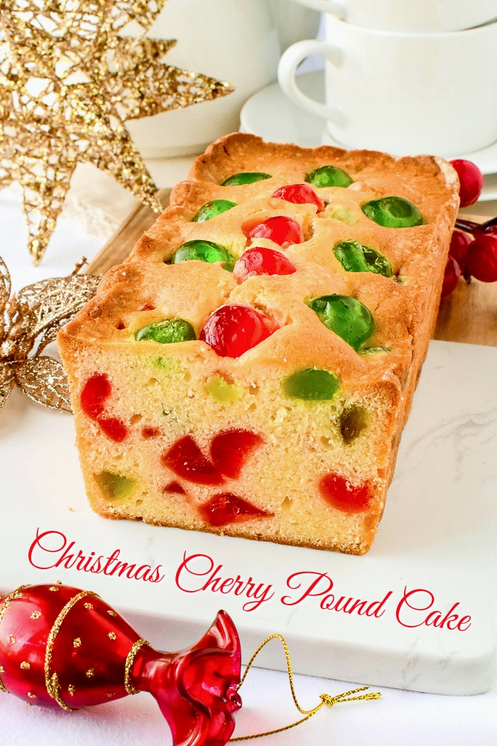 Newfoundland Cherry Cake photo of a sliced loaf cake on a marble board surrounded by Christmas decorations