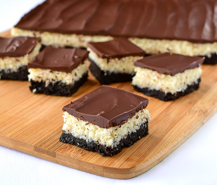 Wide shot of Coconut Bounty Cookie Bars on a wooden cutting board