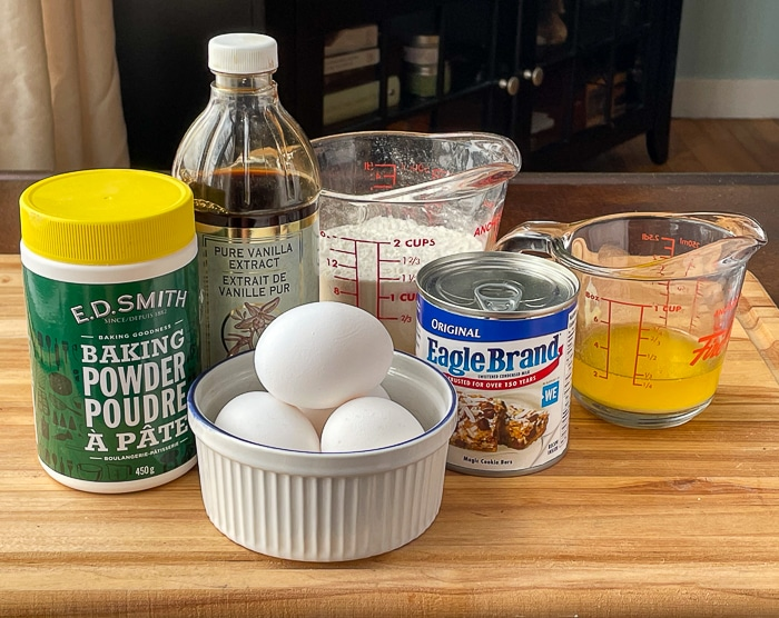 Photo of the 6 ingredients needed for condensed milk cake
