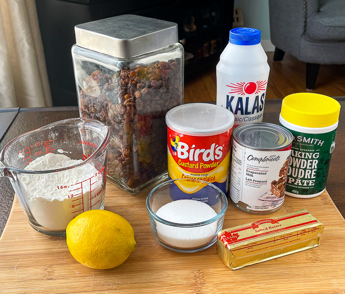 Ingredients for Custard Tea Buns on a wooden cutting board