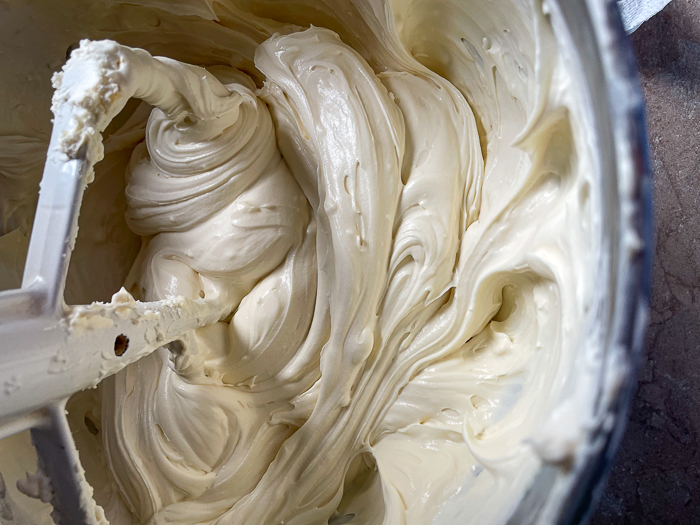 Add part of the whipped cream back the softened cream cheese and beat until smooth.
