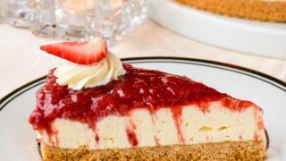 No Bake Strawberry Cheesecake close up photo of a single slice.