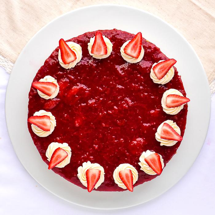 No Bake Strawberry Cheesecake overhead photo of uncut cake