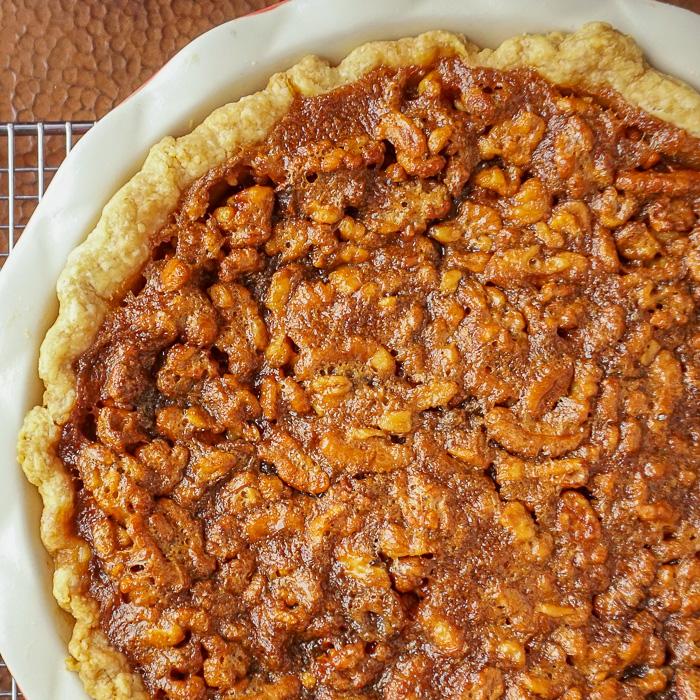 Close up photo of uncut Maple Walnut Pie