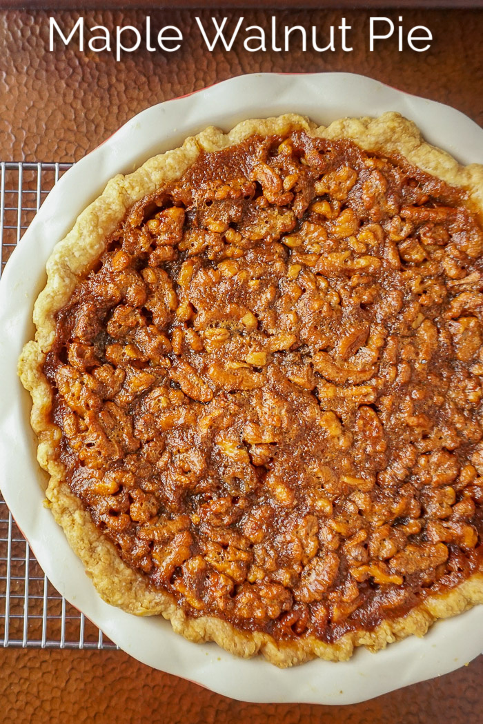 Maple Walnut Pie Photo of uncut pie with title text added for Pinterest