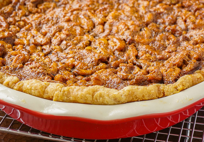 Maple Walnut Pie in a red ceramic pie pan fresh from the oven