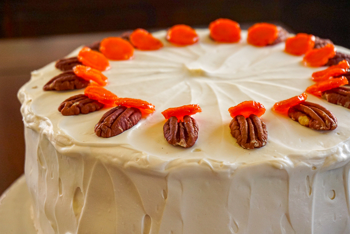 Close up photo of the top of the garnished carrot cake