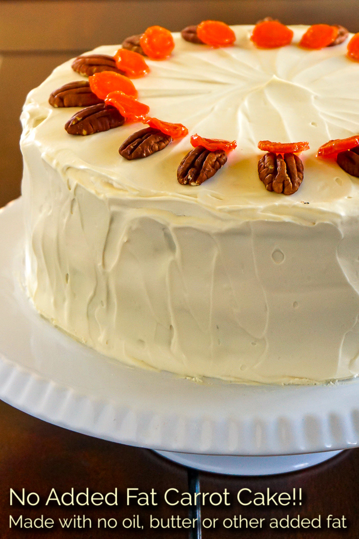 Photo of an uncut no added fat carrot cake with title text added for Pinterest